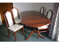 Oval Extending Dining Table and Four Chairs, Dark Wood, Like New.
