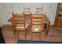 Table & 4 Chairs for sale.