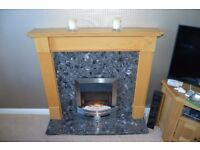 Wooden fire surround with marble hearth and electric fire