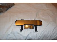 Clip on rear view double mirror.