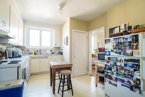 Spacious 2 bedroom with living & dining room, balcony, fireplace