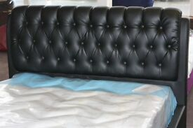 NEW UNUSED. 4ft6 Double Black leather bed frame bedstead. Showroom display, as new