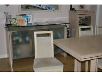 Dining Table and 6 Chairs, Sideboard, Coffee table and Glass TV stand in very good condition.