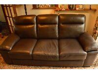 Brown three-seat sofa