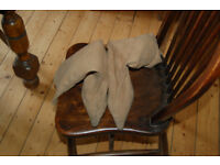 2 pairs of suede boots one pair black and other beige with 4 inch heels size 5/6