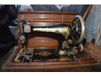 Antique Singer Sewing machine with oak coffin style box