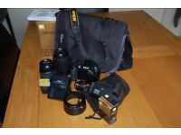 Nikon D3100 14.2MP 18-55 and 55-200 lens.Battery grip x 3 batteries-charger-bag