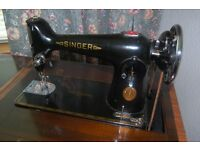 Singer Sewing Machine in its own Cabinet