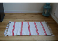 Cream rug with red stripes (95×50cm including tassels) £5