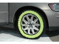 Snow Socks for Cars (1 Pair) - Reviews say things like 'easily passing stuck 4x4s on sheet ice'.
