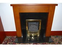 Gas fireplace, black granite backplate and hearth with oak wood surround. Gas fire not included.
