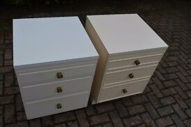 Two bedside cabinets and headboard.