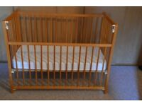 Baby's drop-sided cot in pine. 122 cm x 61 cm. Good condition