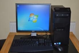Lenovo desktop PC with Dell monitor.