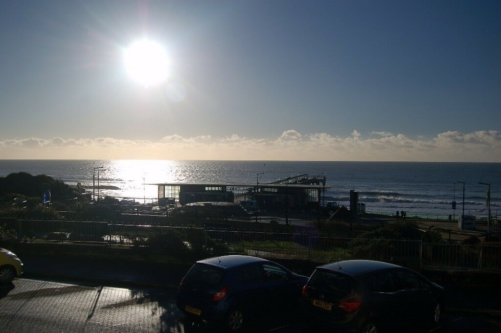 A LARGE UPPER GROUND TWO BEDROOM GARDEN FLAT WITH AMAZING SEA VIEWS