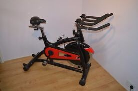 Spinning bike, Exercise bike, Gym equipment.
