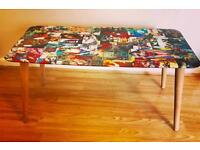 Comic book covered coffee table