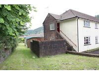 End of terrace two bed ground floor flat in quiet Cwmparc area. No deposit required.
