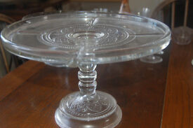 Glass embossed pedestal cake stand approximately 11 inches in diameter