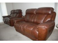 Quality leather 2x2 seater sofas plus 1 armchair. All electric recliners,currently on sale at DFS