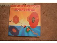 A boxed set of 8 LP's of various types of music, Instant Replay