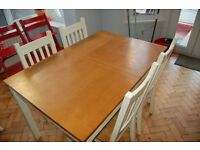 Extendable kitchen table and four matching chairs
