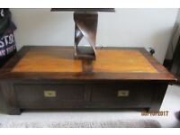 LUXURY WOODEN COFFEE TABLE WITH AMBER WOOD FEATURE .LARGE DRAWERS AND BRASS LATCH HANDLES