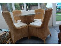 Lovely Wicker Table (glass top)and four chairs