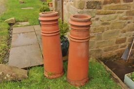 Two 3ft clay chimney pots