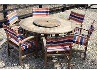 Round teak table and Daisy Wheel plus 6 chairs