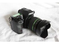 Pentax K7 with 18-55 WR lens. Mint condition.Boxed.