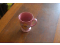 Winnie the Pooh with wings, pink retro mug