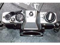 Olympus OM 1O 35 mm film camera.