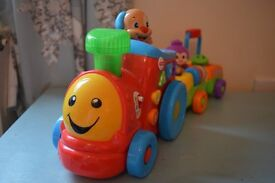 Fisher Price - Laugh and Learn - Puppy's Smart Train - Smart Stages Learning - Motorised Action