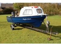 Boat on road trailer 9.9 Tohatsu outboard.