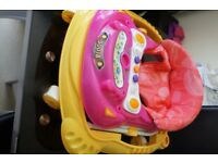 Collapsible pink baby car walker with a light and sound 'dashboard'
