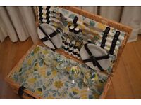 Wicker picnic basket with service for 4, never been used