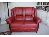 Real leather Suite in Red. Two seater sofa and two armchairs.