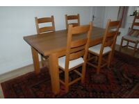 Solid Light Oak Dining Table and Six Matching Chairs.