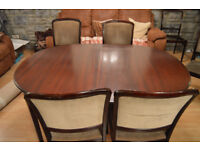 Dining Table extending with 7 chairs Mahogany colour and replacement chair covers.