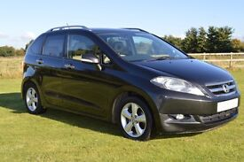 Honda Frv. The perfect 6 seater family car with 3 seats in the front.