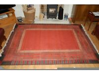Square pattern red rug with fringes