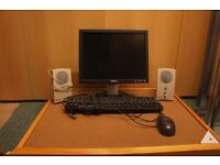 Computer monitor , keyboard, scrolling mouse speakers
