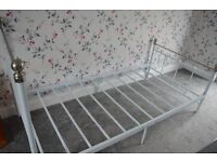 White metal frame single bed.