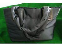 "BLACK SATIN BAG. APPROX SIZE 18"" x 11""."