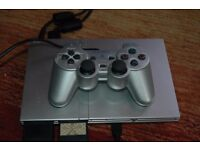 Fully functioning PS2 plus extras inc Buzz pads, super hero,FIFA, Pes & in great condition