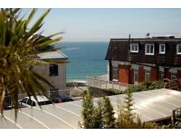 ATTRACTIVE TWO BEDROOM 1st FLOOR FLAT WITH SEA VIEWS & SOUTH FACING BALCONY