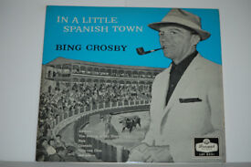 In A Spanish Town Bing Crosby Album. Record in excellent condition. Sleeve in not bad condition.
