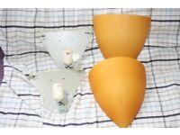 Pair of Ikea Kvinett orange glass wall lights
