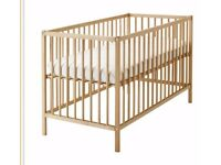 Ikea cot with adjustable height base. Solid beech. Used once.